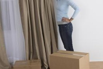 Take down sagging drapes until the center support is installed to prevent bending the rod.