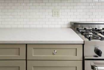 Cut tile to fit around the outlet without its cover for a professional look.