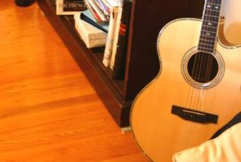A guitar casually placed by a well-stocked vintage bookcase; they make perfect hipster-style accessories.