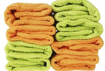 Colorful towels can be made into an attractive and comfortable bath rug.