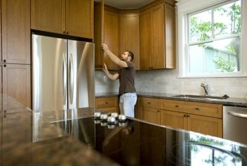 Start with the corners when installing new cabinets in your home.