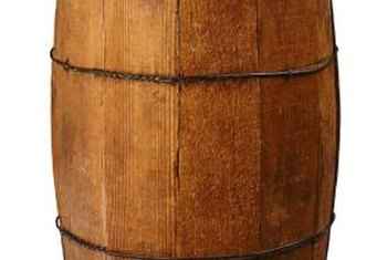 Whiskey barrels become comfortable lounge chairs with padding and fabric.