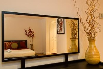 The relfective nature of mirrors helps them make any room feel larger.