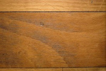 Mix and match or blend in old and new flooring using stain.