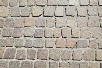 Properly installed pavers can withstand heavy wear at the end of a driveway.