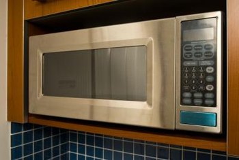 Trim cupboards to fit microwaves.