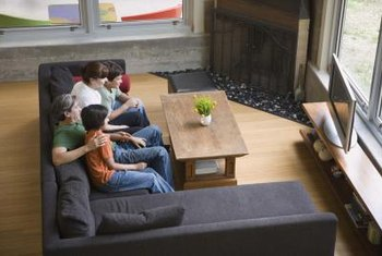 A half wall that houses your TV is an ideal way to divide a living room into areas for formal and casual entertaining.
