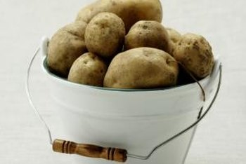 Buckets provide a neat and portable planting container for potatoes.