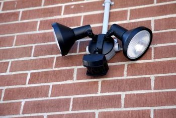 Motion-sensing outdoor floodlights turn on automatically for safety.