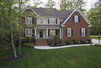 Evergreen hedges make ideal foundation plantings for your front yard.