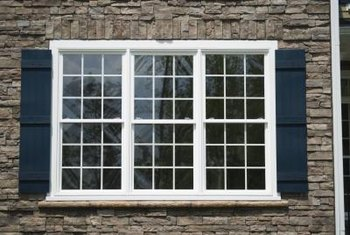 Protect the exterior wood panels on your windows by waterproofing them.