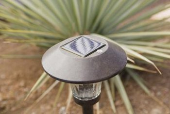Small solar-garden stakes are cheap and their light assemblies can be easily transfered to other containers.