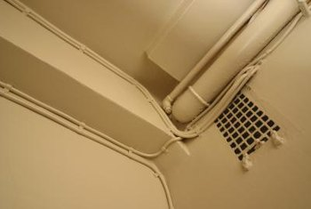 Painting the pipes in your basement the same color as the walls helps disguise them.