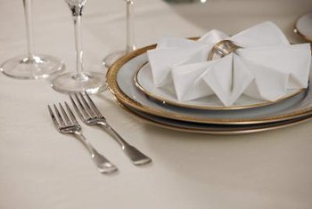 Folded napkin designs add impact to a table setting.