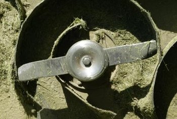 Mower blades pivot around a central point and occasionally need adjusting.