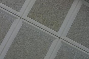 How To Replace A Middle Interlocking Ceiling Tile Check The Alignment Of Rectangular Tiles Or Those With Pattern Before T Replacement