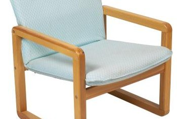 The simple geometry of Mid-Century teak chairs is at home in the living or dining room.