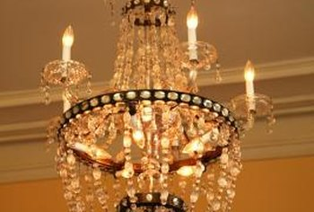 Installing a chandelier to a high ceiling requires equipment that allows you to reach the ceiling safely.