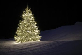 lighting large trees from top to bottom can be painless with the right tools - How To String Lights On A Christmas Tree