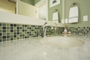 Choose a mid-range green for a multicolored green tile backsplash in the kitchen or bathroom.