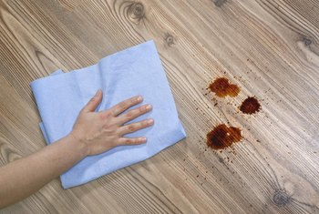 Minimize damage by cleaning up a hair dye spill quickly.