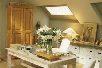 Choosing a light color for the walls of an attic room can make the space appear brighter and more open.