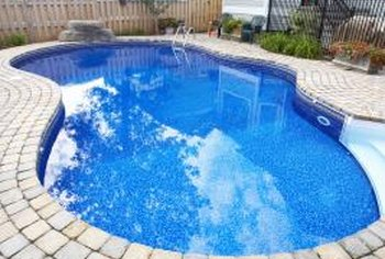 Add a fountain sprayer to an otherwise drab pool.