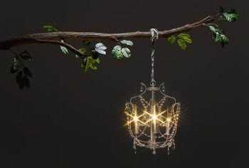 A fake chandelier can hang in a tree or over a party table.