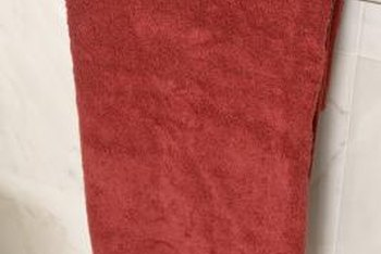 Burgundy towels, the color of translucent wine, polish a grown-up bathroom.