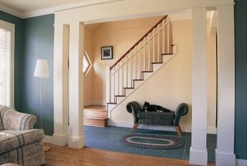 Neutral-colored hallways set off a darker-colored living room.