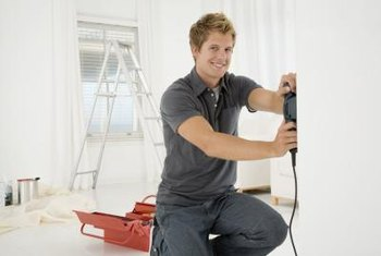 A belt sander quickly removes textured paint from walls.