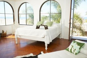 An arched curtain rod window treatment shows the window's shape.