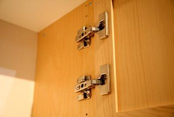 Concealed hinges use built-in adjusters for balance.