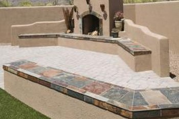 Building a retaining wall around your outdoor fireplace helps distinguish the area.
