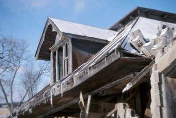 Hire a home inspector to assess the damage on a boarded-up house.