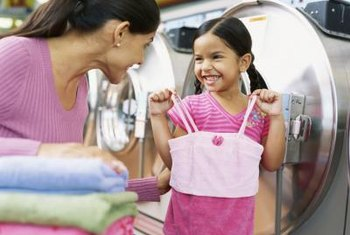 Add vinegar to your washer's rinse cycle to help brighten clothes.