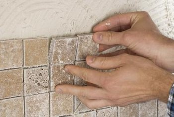Getting rid of old tile adhesive is a must before resetting new tile.