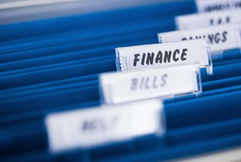 Project accountants must keep track of multiple bills, statements and invoices.