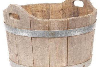 Plant your jujube tree in a wooden half barrel.