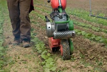 Use a rototiller to prepare soil in a large garden.