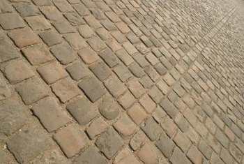 Apply sealer to enhance color and prevent stains on stone pavers.