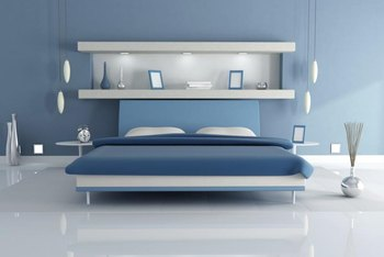 Pure White Shelves Bring Out The Cool Tones Of Light Blue Walls
