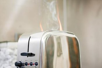 Air circulation and vinegar help remove lingering kitchen smoke odors.