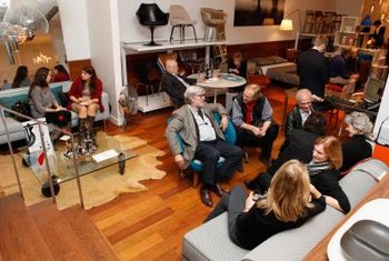 "Screeners of the movie ""Eames: The Architect and Painter"" hang out on the designer's furniture before the show in November 2011."