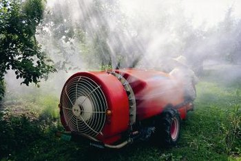 Powerful sprayers help cover trees with various sprays that are used to control pests of cherries in commercial orchards.