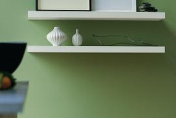 Wall shelves serve as both functional and decorative features.