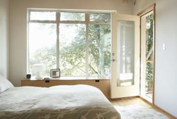 Pale walls and lots of natural light open up a small bedroom.