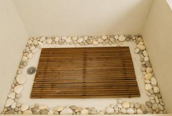 Teak shower liners and loose rocks are an noninvasive way to get a spa feeling in your shower.