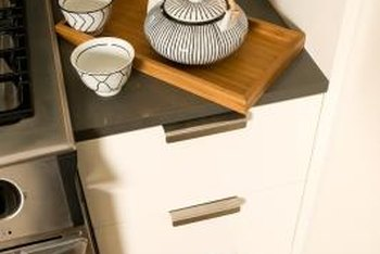 A cabinet end panel allows full overlay drawers to open freely.