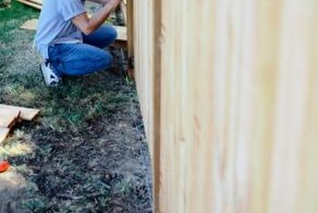 A nail gun makes quick work of building a fence.